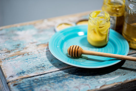 Jars with mustard and honey