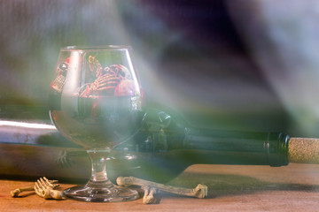 Skulls in the blood glass and wine on wooden table to creative for design and decoration on background.Copy space.Concept halloween day.