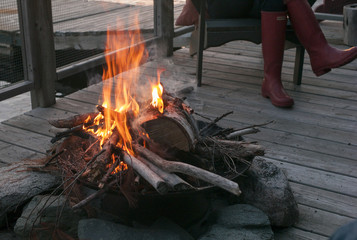 Campfire on dock, Lake of The Woods, Ontario, Canada