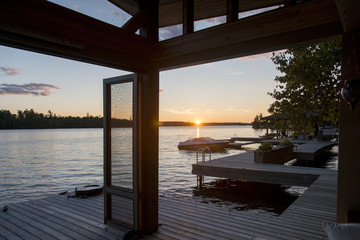 Dock over the lake at sunrise, Lake of The Woods, Ontario, Canada