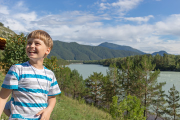8 year old happy boy in mountains Altai, Chemal, Siberia