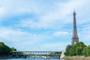 PARIS, France - JUNE 23, 2018 : the Eiffel Tower on Summer, 2018 in Paris. Illuminated Eiffel tower is the most popular travel place and global cultural icon of the France and the world.