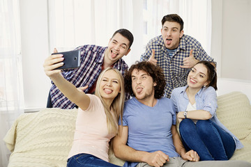 A group of friends are photographed on a camera indoors indoor.