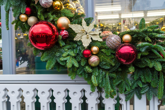 traditional New Year's wreaths and garlands, decorated with balls and ribbons, street architecture