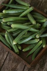 preparing fresh okra vegetables