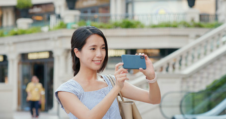 Woman use of mobile phone for taking photo