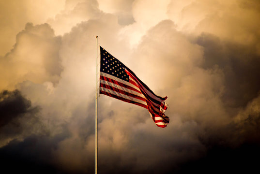 The American flag flies high as a storm approaches