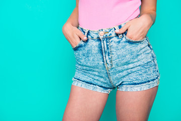 Close-up picture of young slim perfect girl legs and waist, jean