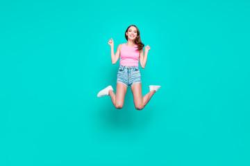 Full-legh portrait of happy brunette student girl in jump isolat
