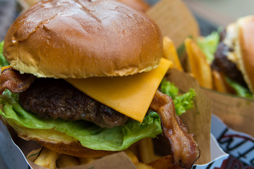 Delicious fresh burger close up. Selective focus with shallow depth of field