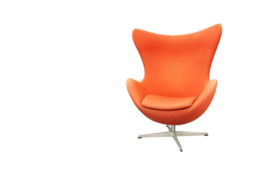 Orange fabric swivel armchair on metal stand in modern curve design for living room with leaning area of head isolated on white background.