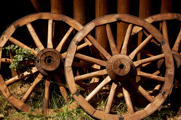 Old wooden wheels from the cart. Retro, country life. The first way to travel