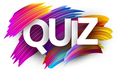 Quiz sign with colorful brush strokes.