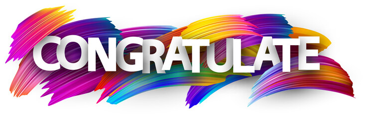 Congratulate banner with colorful brush strokes.