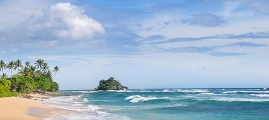 Picturesque beach and blue sky. Coastline of Sri Lanka. Wide photo.