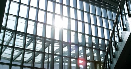 Fotomurales - Walking inside the building with window sunlight flare