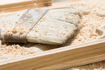 Wooden board and brush for cleaning wood chips