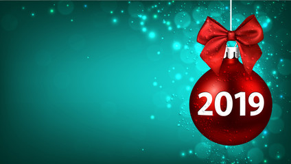 Green 2019 New Year background with red Christmas ball.