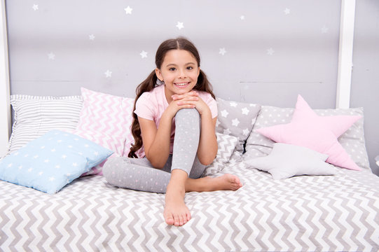 Wish her sweet dreams. Girl child sit on bed her bedroom. Kid prepare go to bed. Pleasant time relax cozy bedroom. Girl kid long hair cute pajamas relaxing before sleep. Time to sleep or nap