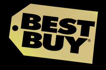 The company logo for Best Buy is displayed on a screen on the floor of the NYSE is seen in New York
