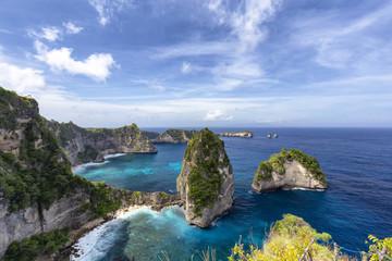 Blue sky over beautiful blue waters of the Raja Lima islands just off the coast of Nusa Penida, Indonesia.