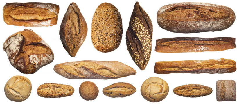 From above of assorted composition of various bread loaves and buns and baguettes isolated on white background