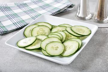 Fototapeta Plate of sliced cucumbers obraz
