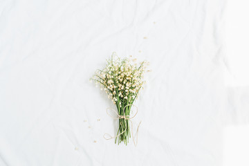 Wall Murals Lily of the valley Lily of the valley flowers bouquet on white background. Flat lay, top view minimal floral concept.