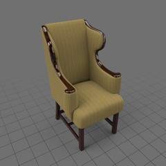 Wooden upholstered wingback chair