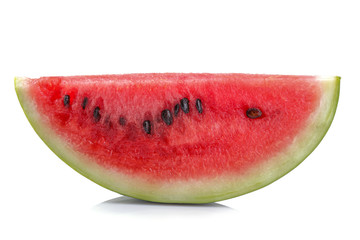 Ripe red slice of watermelon with sunflower seeds closeup on white isolated background