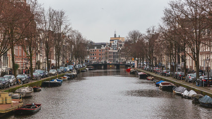 View of Canal and Houses in Amsterdam, the Netherlands