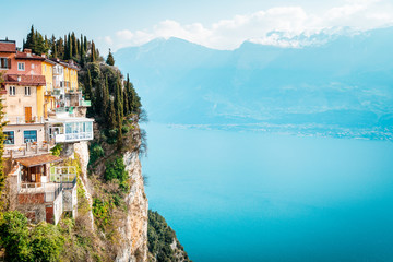 The cliffs of Tremosine sul Garda, view to the balconies at the cliffs next to the abyss, in the background Lake Garda, Italy Wall mural