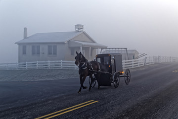 A Horse and Carriage Passes an Amish School House