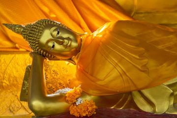 Beautiful reclining golden Buddha Image