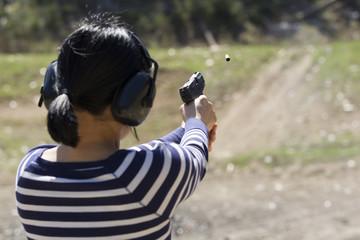 Woman does target practice at range.