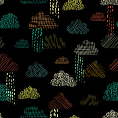 Rain doodle clouds in the sky seamless vector pattern background. Teal, green, orange, and yellow silhouettes of textured clouds on black background. Great for kids, fabric, paper, web banners, cards