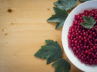 background of ripe juicy red currant berries. top view - horizontal photo.