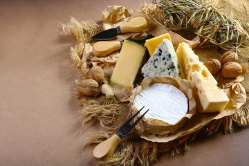 cheese board, cheese with blue mildew, Camembert or brie cheese circle, Cheese Serving Knife. top view image with copy space, set