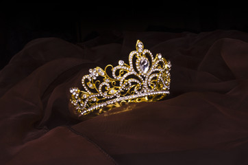 Wall Mural - gold crown with diamonds isolated on the fabric