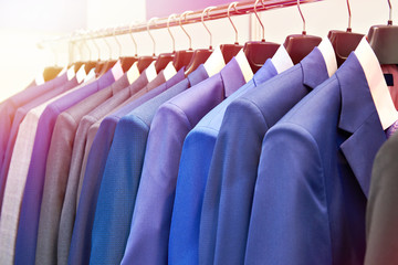Men's suits with shirts in clothing store