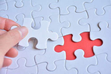 Jigsaw puzzle on a red background
