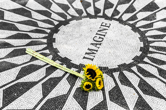New York City. The caption Imagine on the memorial mosaic at Strawberry Fields John Lennon Memorial in Central Park, Manhattan