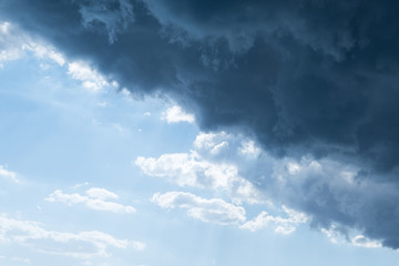 Stormy cumulus clouds of gray and blue background before a thunderstorm