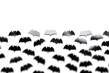 Black bat shapes on a white background. Halloween background
