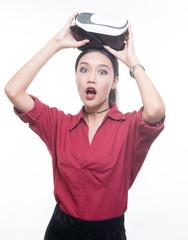 beautiful asian woman in red shirt showing VR equipment