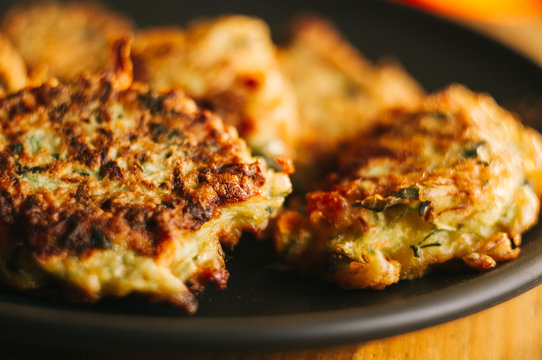 Fried vegetable fritters with zucchini, carrots, herbs, eggs, and cheese.
