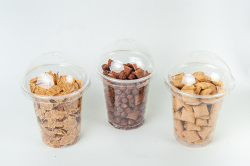cereal breakfast in transperent boxes at white background