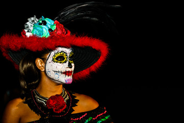 Cabo San Lucas, Mexico - 2018. Closeup portrait of unknown young woman with sugar skull makeup. Dia de los muertos. Day of The Dead.