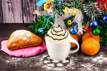 Christmas decorations on a dark wooden background, pastries, biscuits, tangerines, coffee and marshmallow.