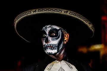 Cabo San Lucas, Mexico - 2018. Closeup portrait of unknown man with sugar skull makeup. Dia de los muertos. Day of The Dead.